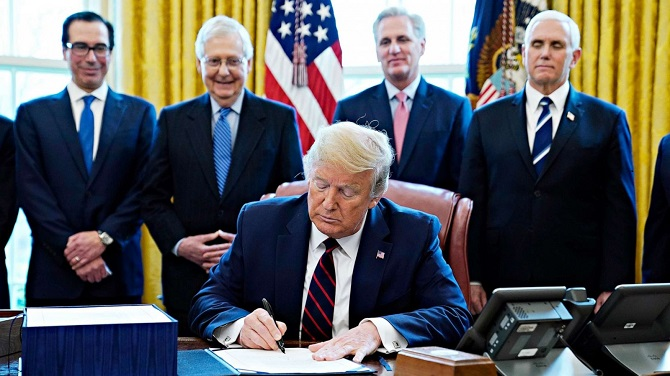 BREAKING HUGE: Trump Signs $2.3 Trillion Relief and Spending Bill, Says More To Come- See Here